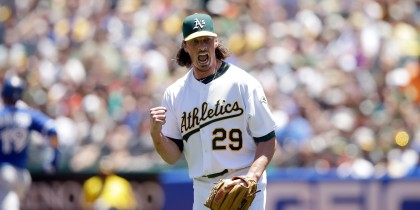 OAKLAND, CA - JULY 06:  Jeff Samardzija #29 of the Oakland Athletics reacts after the Athletics turned a double play to end the first inning of their game against the Toronto Blue Jays at O.co Coliseum on July 6, 2014 in Oakland, California.  Samardzija is pitching his first game for the Athletics.  (Photo by Ezra Shaw/Getty Images)